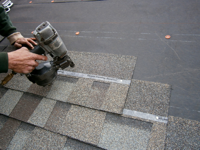 Air nailer shingling better hand nailing