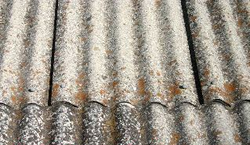 corrugated panels containing asbestos roofing material