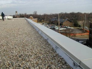 Hot mop roofing installation with ballast